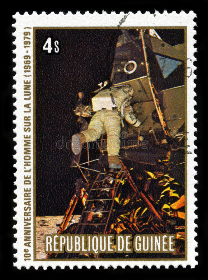 Apollo 11 Moon Landing. REPUBLIC OF GUINEA - CIRCA 1979: A postage stamp from the Republic of Guinea commemorating the 10th Anniversary of the Apollo 11 Moon stock image