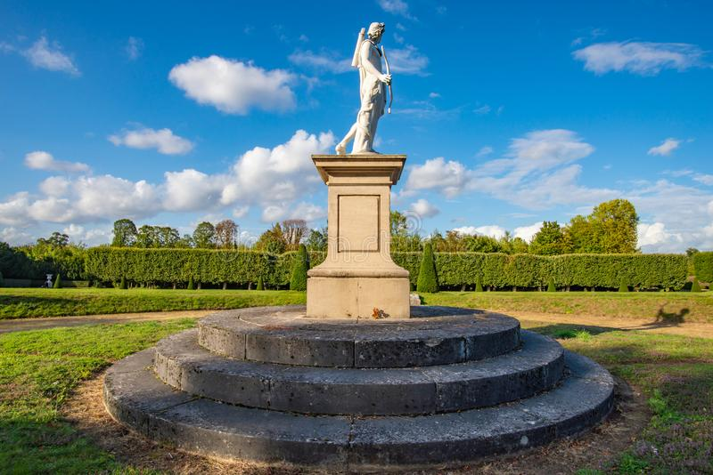 Apollo statue in a classical french formal garden, Champs-sur-Ma royalty free stock photography