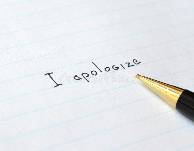 Apology letter. Handwritten apology letter on white paper stock images