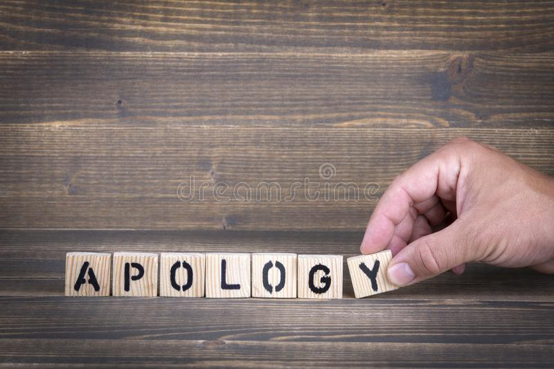 Apology. Wooden letters on the office desk. Informative and communication background stock photo