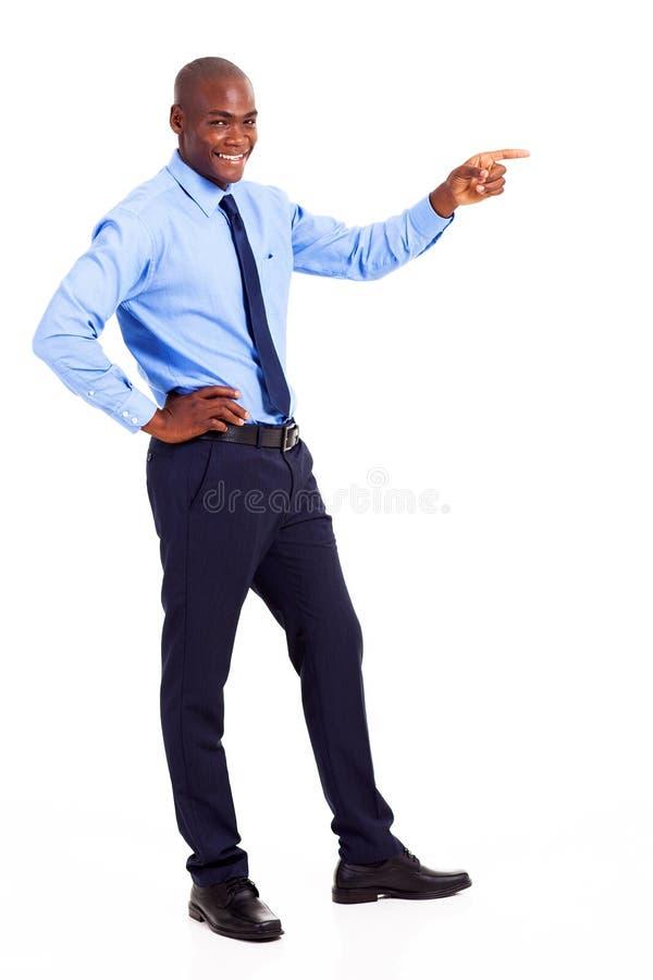 Apontar africano do homem de negócios imagem de stock