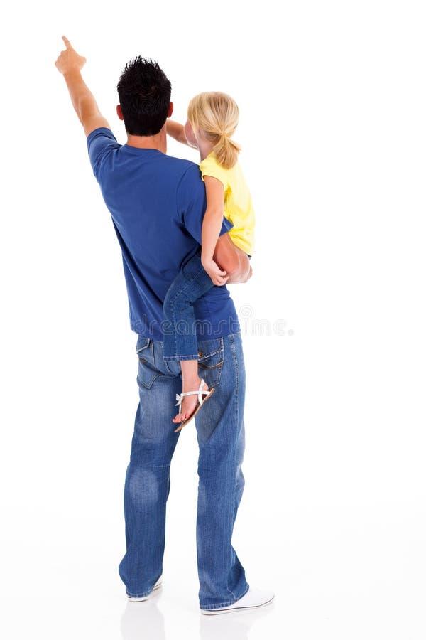Apontar da filha do pai imagem de stock