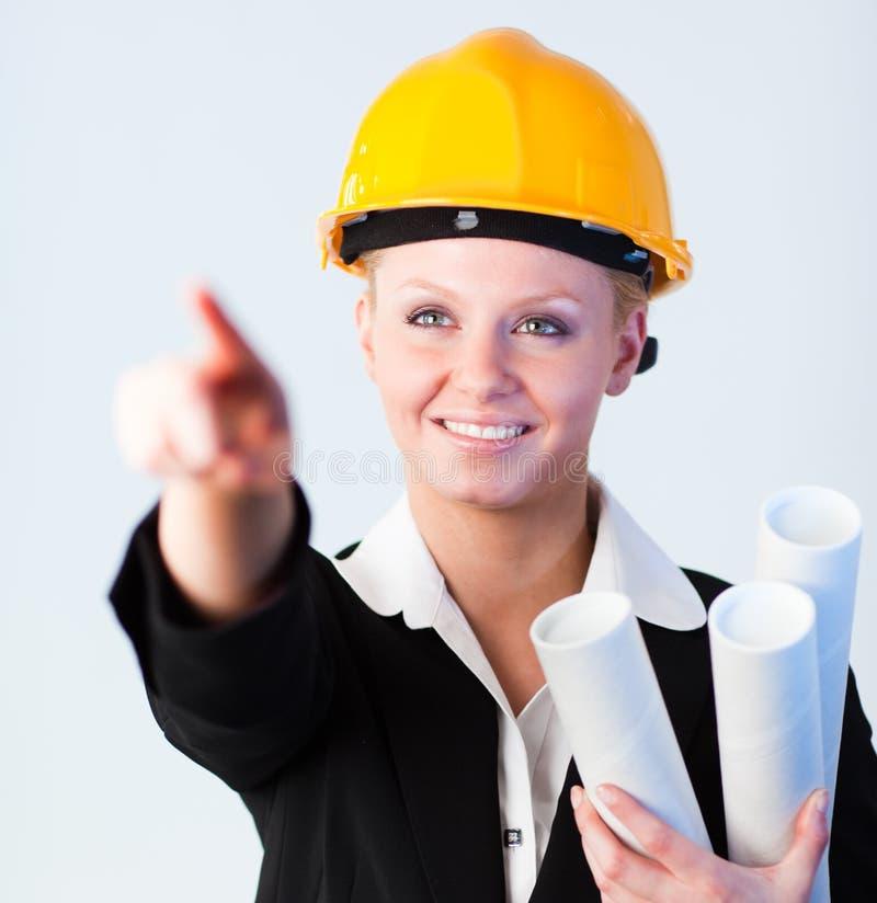 Apontar fêmea do trabalhador da construção foto de stock royalty free