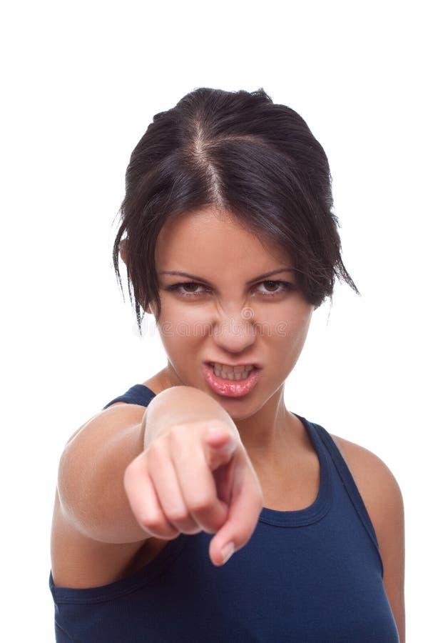 Apontar irritado da mulher imagem de stock