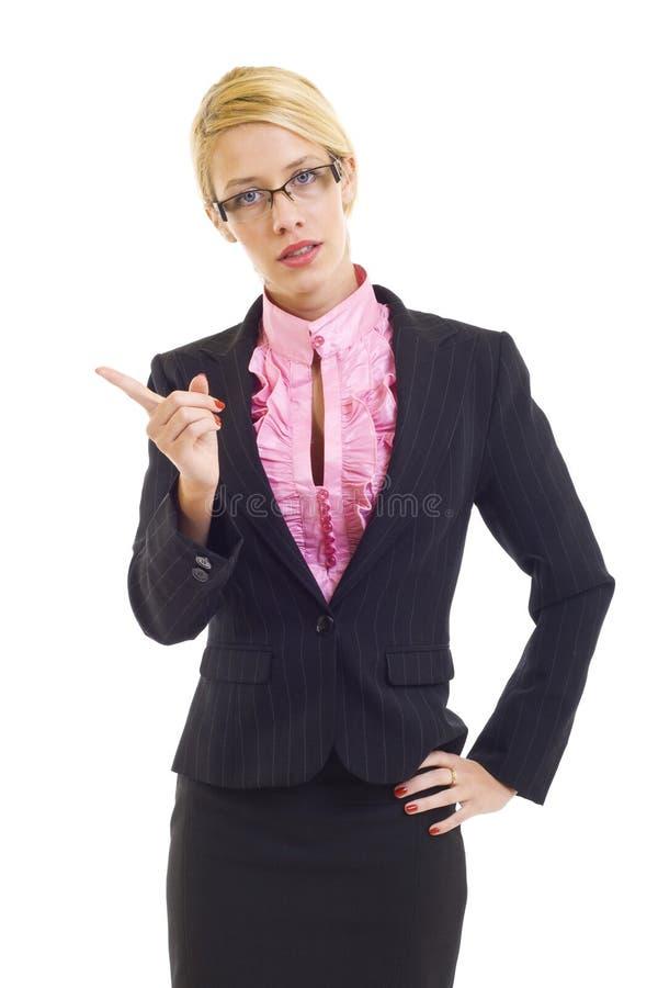 Apontar irritado da mulher de negócios imagem de stock