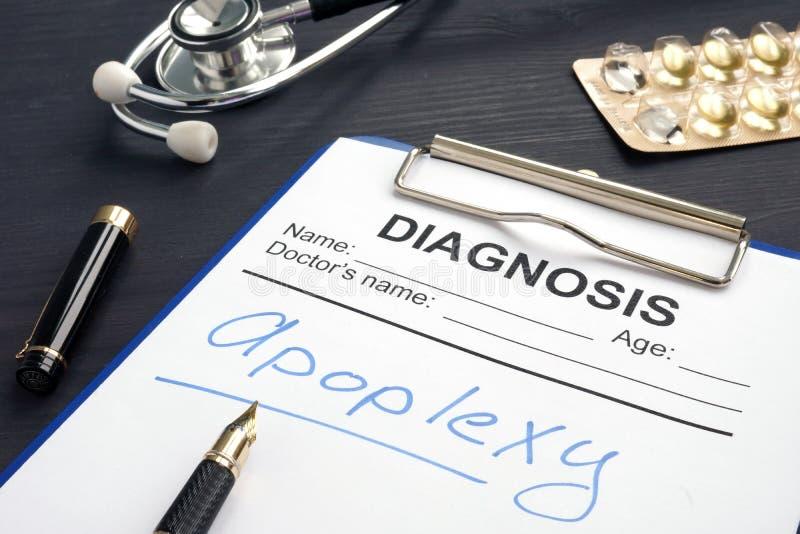 Apoplexia escrita em um formulário do diagnóstico fotografia de stock