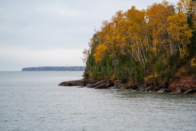 Apostle Islands National Lakeshore along Lake Superior in Wisconsin during fall color season on overcast day.  stock images
