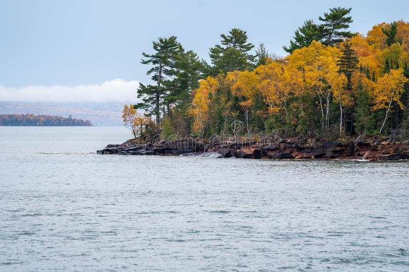 Apostle Islands National Lakeshore along Lake Superior in Wisconsin during fall color season on overcast day in Autumn.  royalty free stock image
