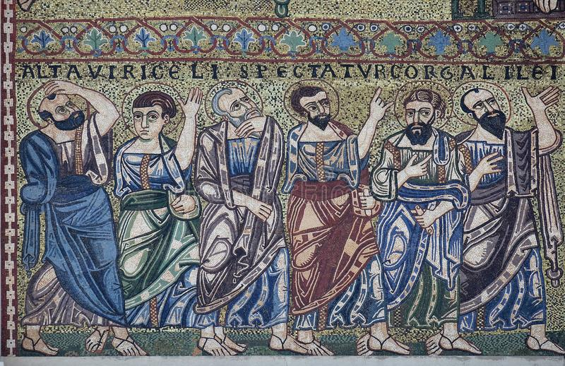 Apostles. Mosaic on the facade on Romanesque Basilica of San Frediano, Lucca, Tuscany, Italy royalty free stock photos