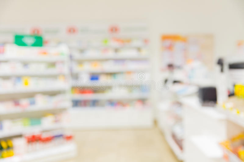Apotek- eller apotekrumbakgrund royaltyfri bild