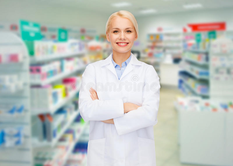 Apotekareapotek eller apotek för ung kvinna royaltyfria foton