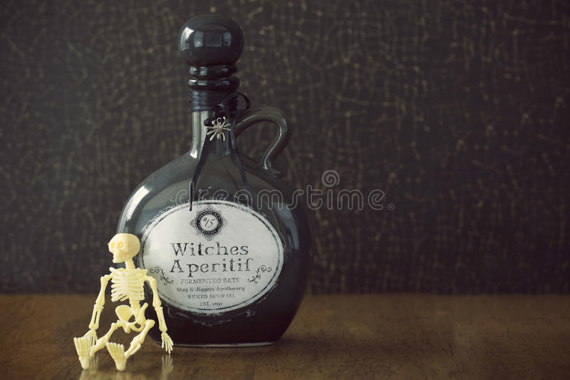 Apothecary jar of witches brew with skull stock images