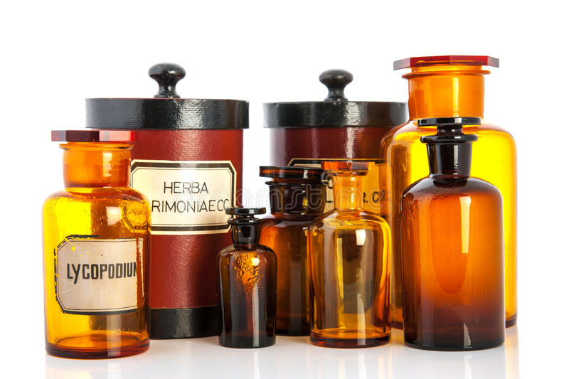 Apothecary pots with ingredients for medicins. Isolated over white background stock photo
