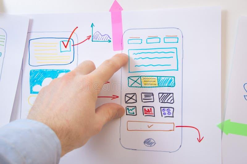 App design smartphone. Ui Ux designer. Working with paper prototypes royalty free stock photos
