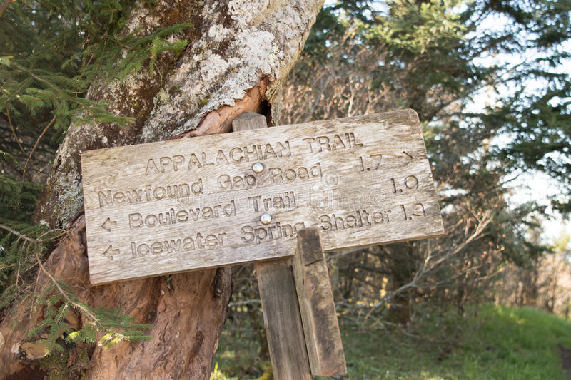 Appalachian Trail Distance Sign Leans Against Tree. In Smokies royalty free stock photos
