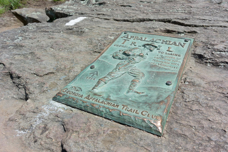 Appalachian Trail Plaque on Springer Mountain. A copper plaque marks the beginning (or end) of the famed Appalachian Trail stock photo