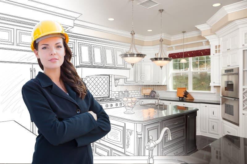 Appaltatore femminile sopra il disegno della cucina che gradua alla foto fotografia stock