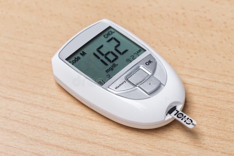 Apparat för att mäta kolesterol och insulin Blodprov royaltyfria bilder