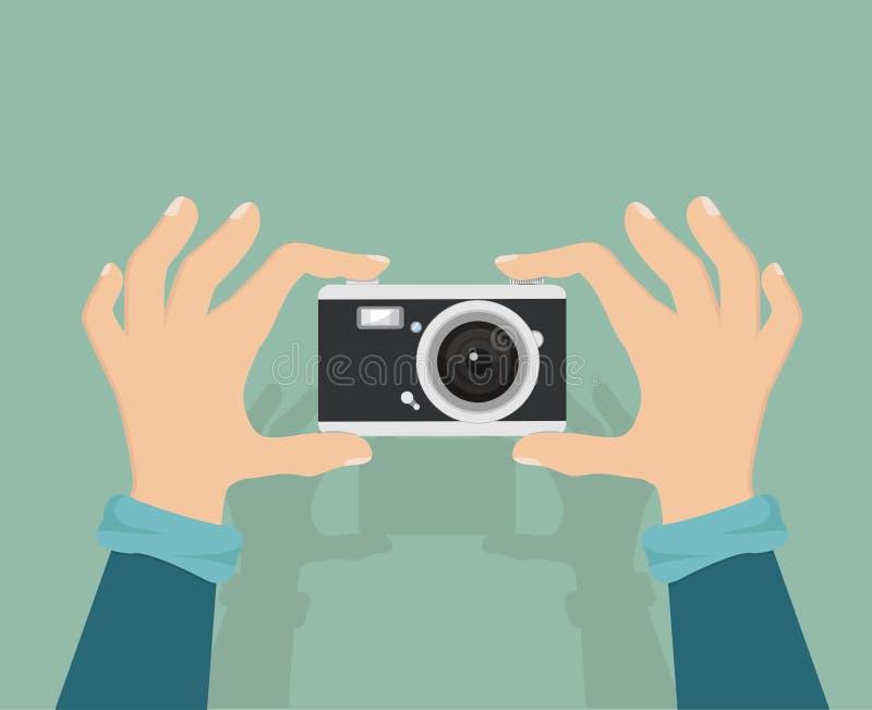 appareil-photo avec la main le tenant illustration libre de droits