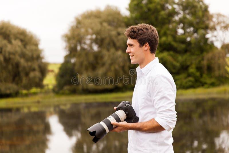 Appareil-photo de dslr de photographe photographie stock