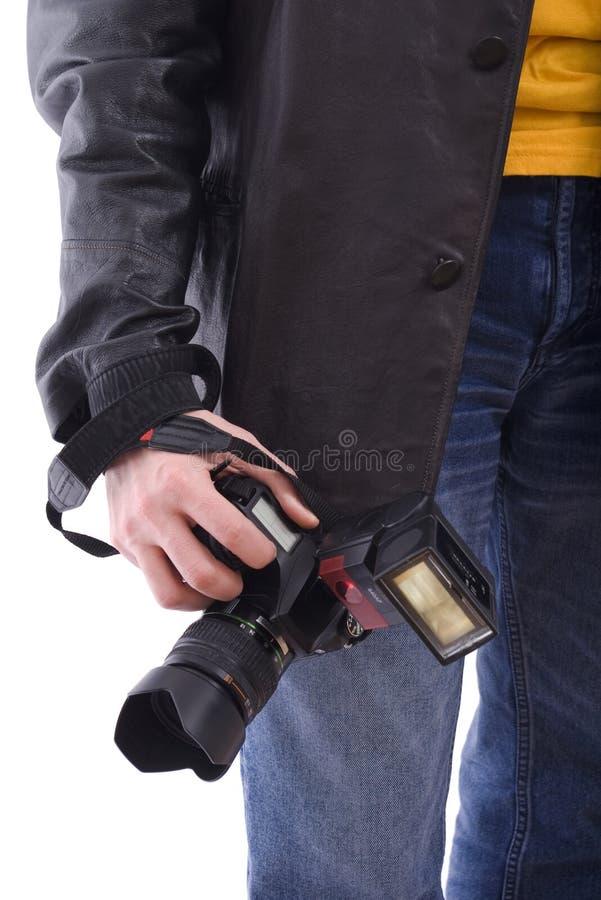 Appareil-photo moderne de la photo SLR dans la main du photographe image stock