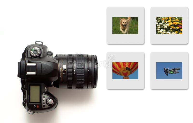 Appareil-photo moderne de slr d'isolement avec des diapositives en couleurs photo libre de droits