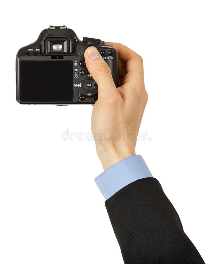 Appareil-photo noir de photo dans la main d'un homme photo stock