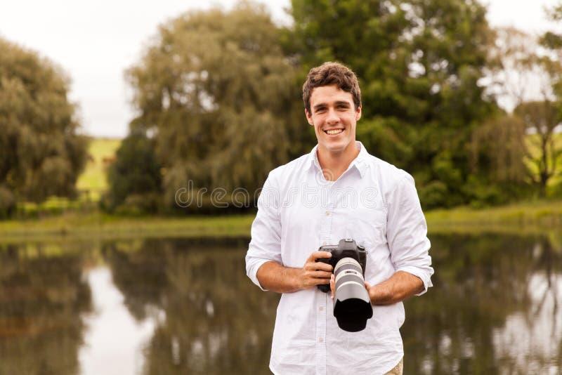 Appareil photo numérique d'homme photos stock
