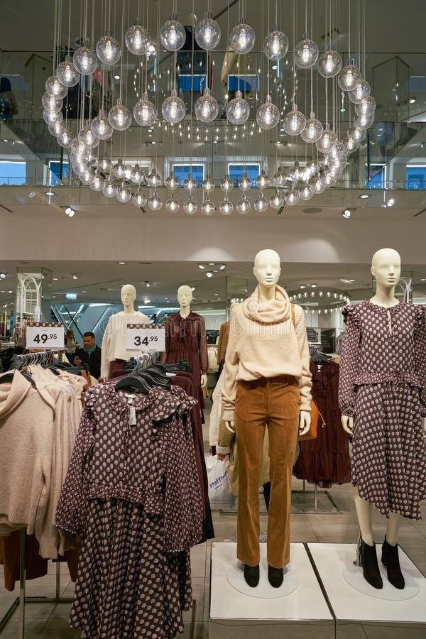 Apparel store. ZURICH, SWITZERLAND - CIRCA OCTOBER, 2018: interior shot of H&M store in Zurich stock images