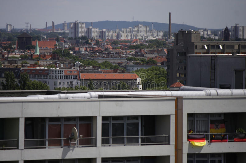 Appartement buildings. CIRCA JUNE 2014 - BERLIN: appartement buildings in the multinational Kreuzberg district of Berlin with national flags during the football royalty free stock image