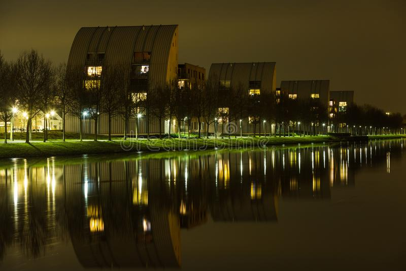 Appartement buildings on the shore of the Zuid Willemsvaart. The typical appartement buildings that are situated at the shore of the canal called Zuid royalty free stock images