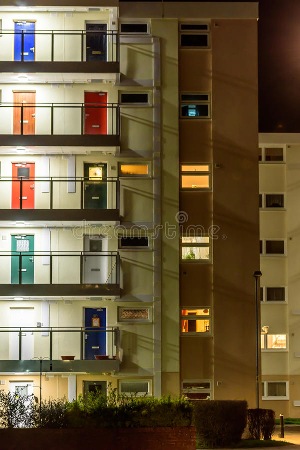 Appartment building with multi color doors at night royalty free stock photos