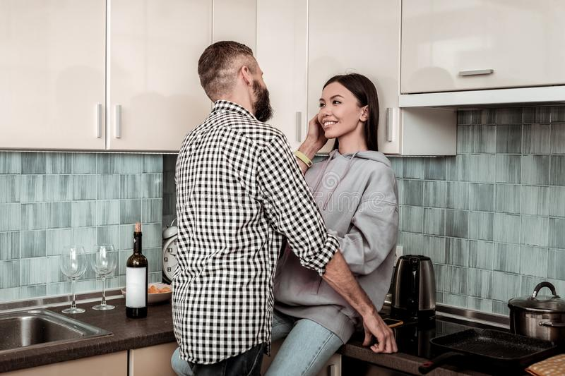Appealing young woman looking at her handsome husband royalty free stock images