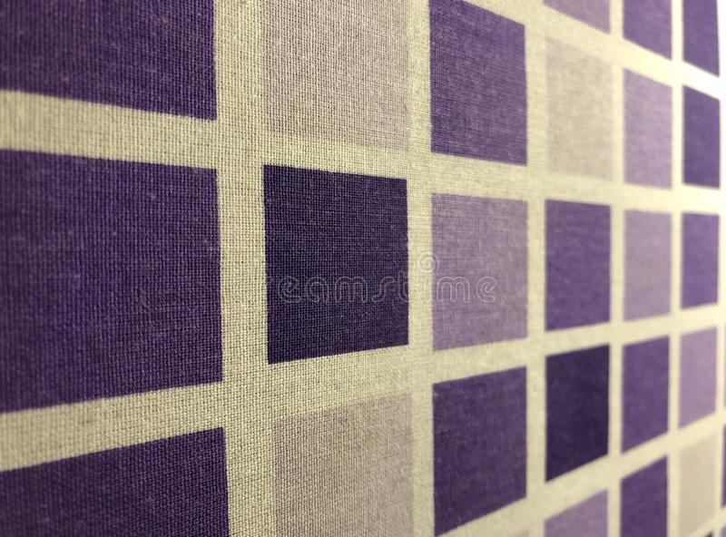 Appearance of plaid textile surface with purple squares stock images