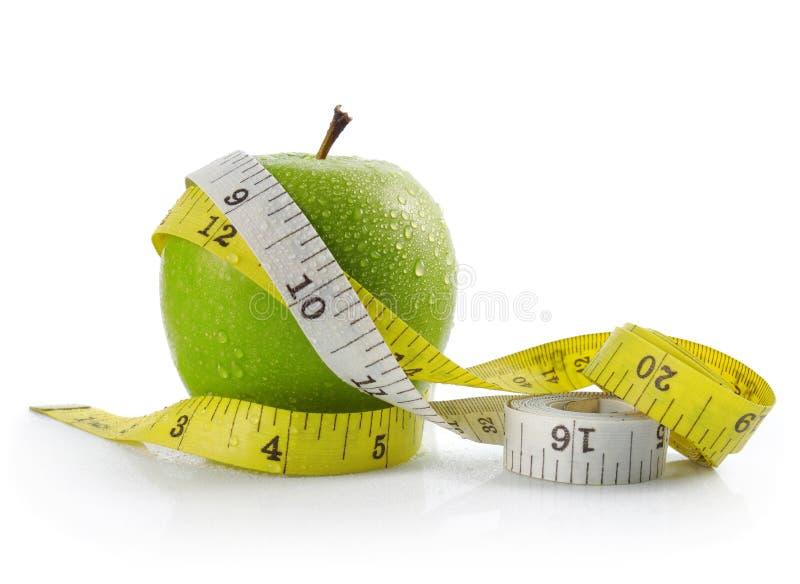 Appel en het meten van band stock foto