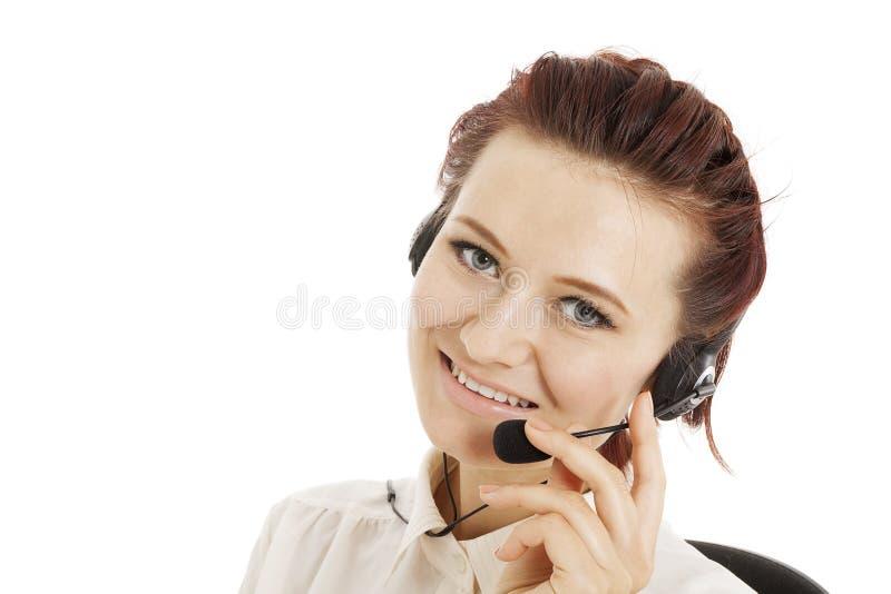 Appellmitt som ler operatören med telefonhörlurar med mikrofon royaltyfria bilder
