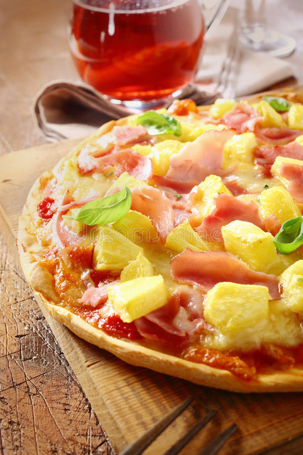 Appetising ham and pineapple Italian pizza stock image