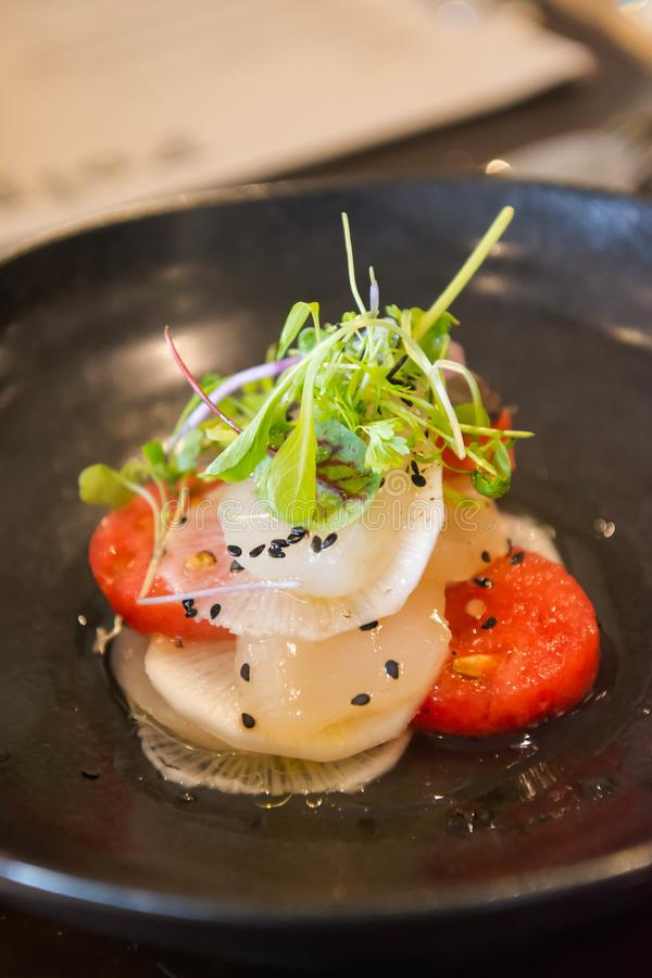 Pickled scallop and radish with sweet watermelon stock image