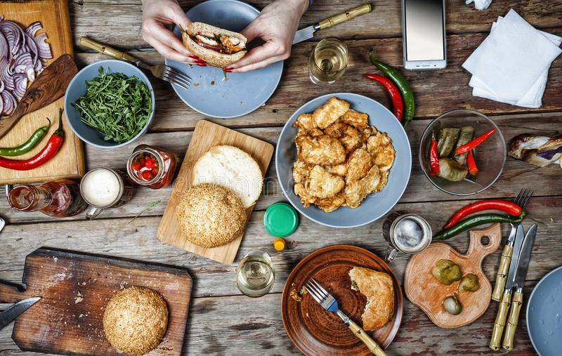 Appetizer,burger, snacks, beer, beef, dinner, eat, fastfood, restaurant, sauce, served, authentic food. Dinner outdoor table with burger, salad and snacks on royalty free stock image