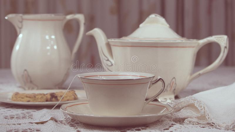 Appetizer in elegant porcelain tableware consisting of cup, plate, teapot and milk. stock photo