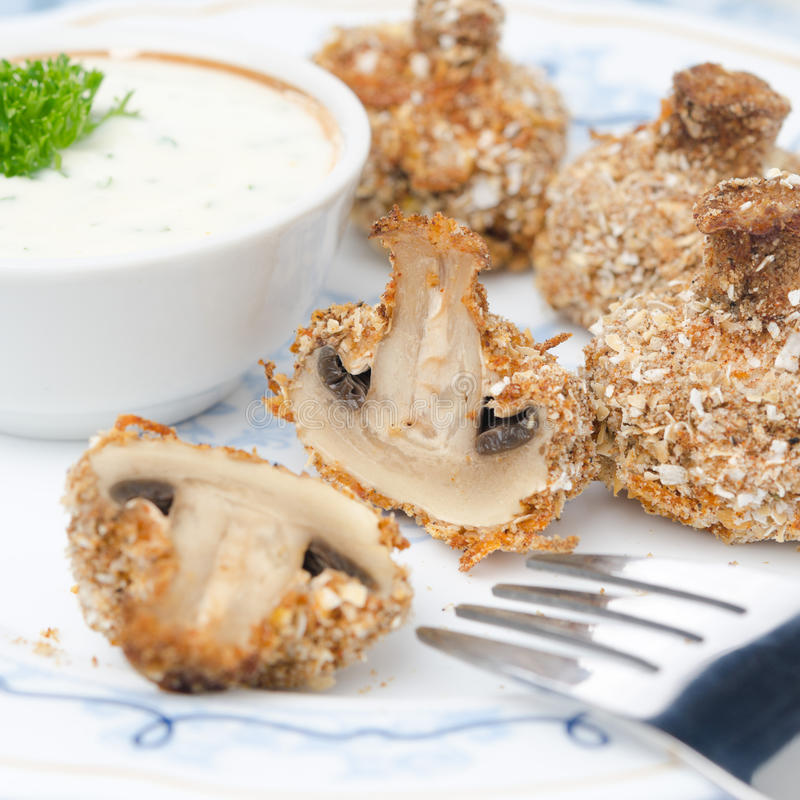 Appetizer of fried mushrooms with yogurt sauce stock photography