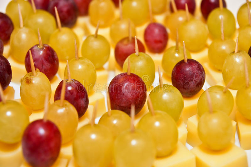 Appetizer from grapes. Small appetizer from grapes on the festive table stock photo