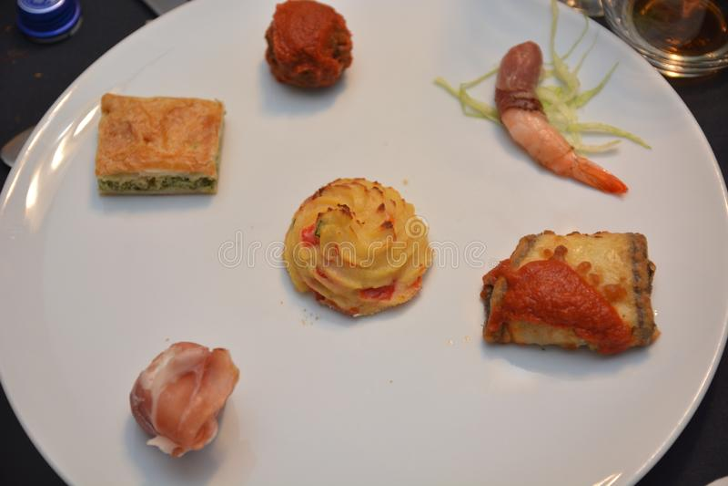 Appetizer italian dish on table aubergine fish meat potato prosciutto gourmet food. Nutritio stock image