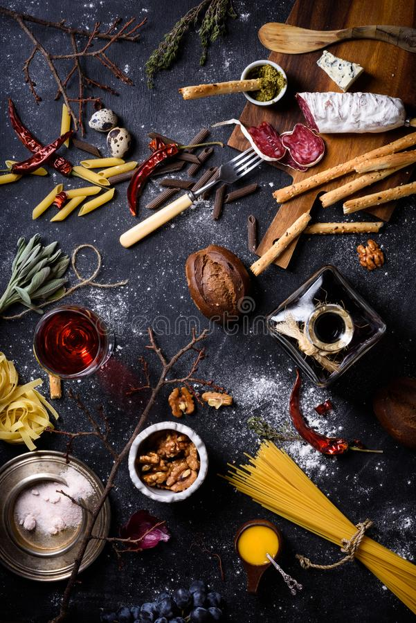 Appetizer, Italian kitchen ingredients. Pasta with antipasto. To. Appetizer, Italian kitchen ingredients. Pasta with antipasto, cheese, grissini bread sticks stock photography