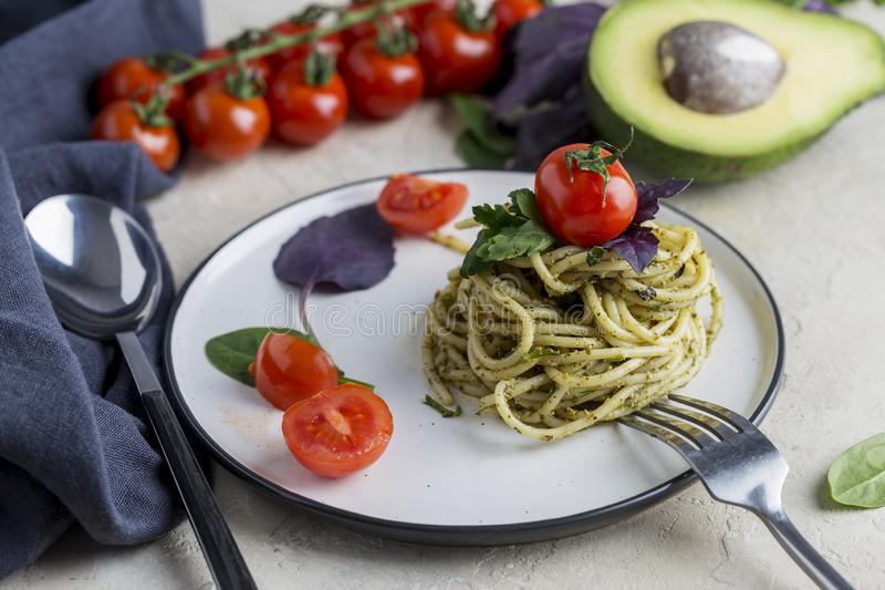 Appetizer Italian pasta with pesto and cherry tomatoes stock images