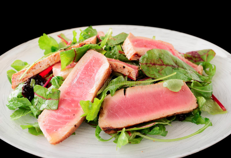 Download Appetizer With Rare Fried Tuna Isolated On Black Stock Image - Image: 35274641