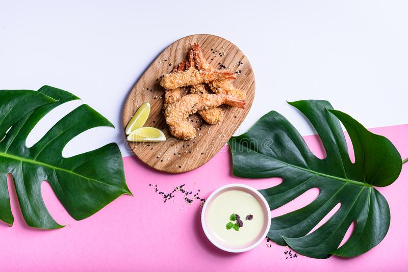 Appetizer roasted tempura cajun shrimps, fried prawns with spices. Asian seafood royalty free stock photography