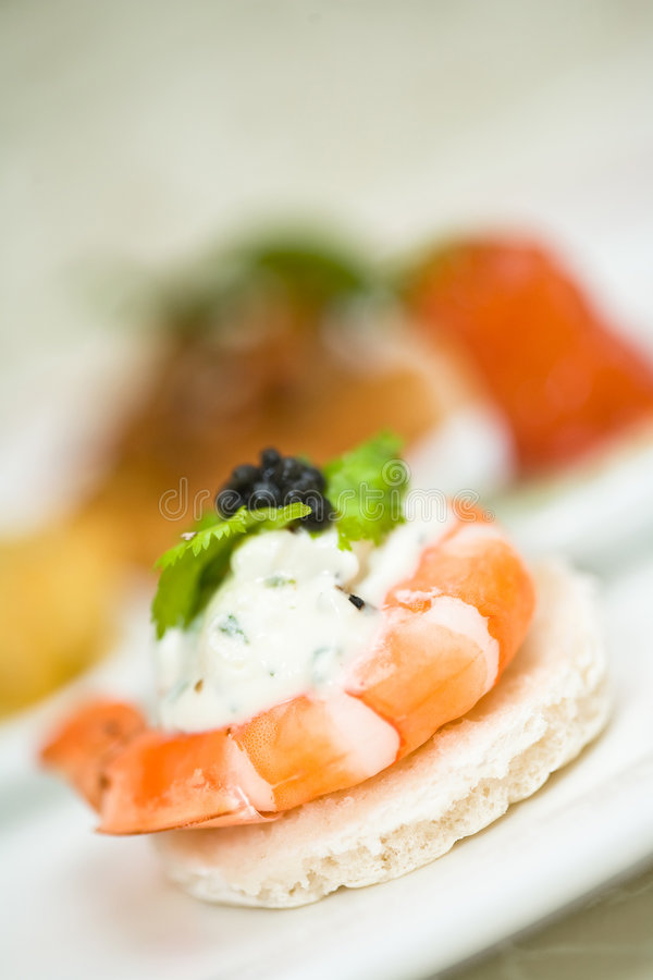 Appetizer of shrimp with caviar stock photography
