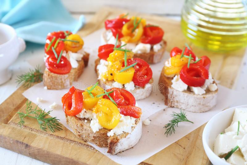 Appetizer. Slice of bread, cottage cheese and grilled bell pepper with olive oil royalty free stock photos