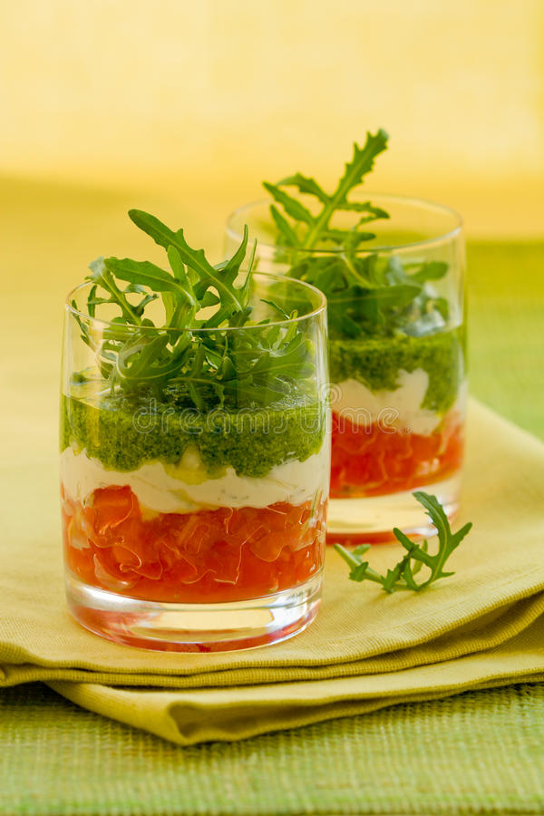 Appetizer with tomato,cheese and pesto. In glasses stock photography